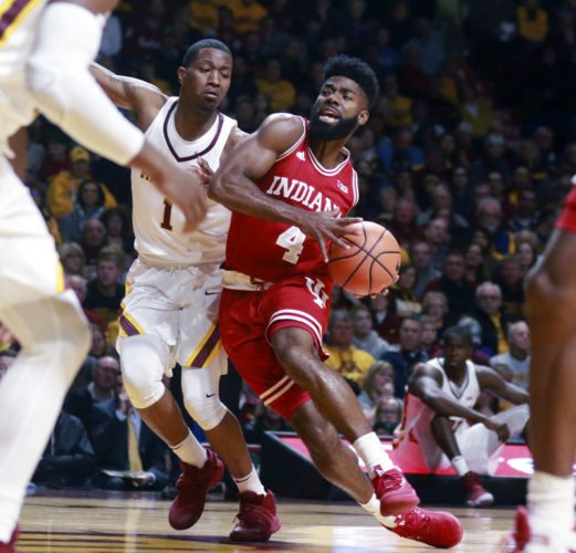 Indiana's Robert Johnson (4) drives to the basket covered by Minnesota's Dupree McBrayer (1) during the first half of a game Saturday in Minneapolis. (By TheAssociated Press)