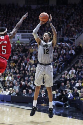 Purdue forward Vincent Edwards (12) shoots over Nebraska guard Glynn Watson Jr. (5) in the second half of a game in West Lafayette Saturday. Purdue defeated Nebraska 74-62. (By The Associated Press)