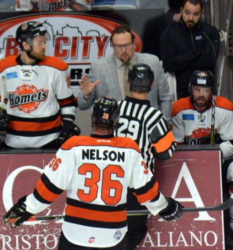 Komets coach Gary Graham argues with referee Lucas Martin late in the third period Saturday night. (By Blake Sebring of News-Sentinel.com)