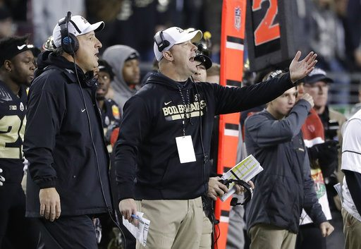 Purdue coach Jeff Brohm, center, yells from the sideline during Purdue's win over Arizona on Dec. 27 in the Foster Farms Bowl in Santa Clara, Calif. (Photo by the Associated Press)