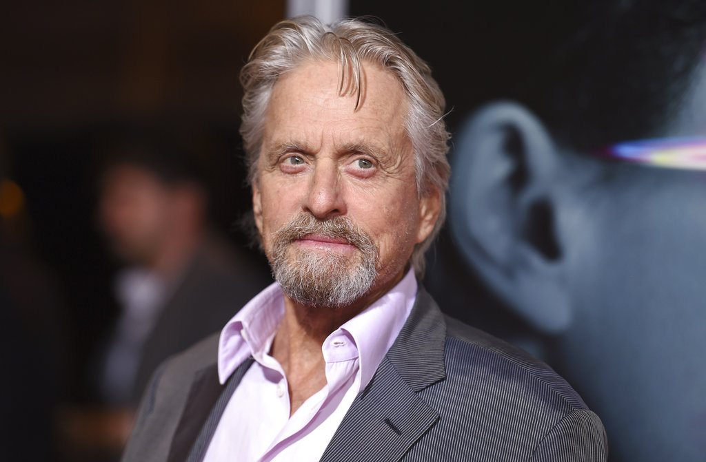 """FILE - In this Sept. 27, 2017 file photo, Michael Douglas arrives at the world premiere of """"Flatliners"""" in Los Angeles. Douglas has come forward to vigorously deny an allegation of sexual misconduct from three decades ago _ before even the publication of the claim. The two-time Oscar winner told Deadline that he anticipated an upcoming report would contain a claim by a former employee that he masturbated in front of her about 32 years ago. (Photo by Richard Shotwell/Invision/AP, File)"""