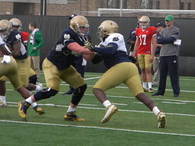 Notre Dame offensive lineman Mike McGlinchey, left, blocks defensive end Jay Hayes during a drill in a practice in South Bend last April. (By Tom Davis of News-Sentinel.com)