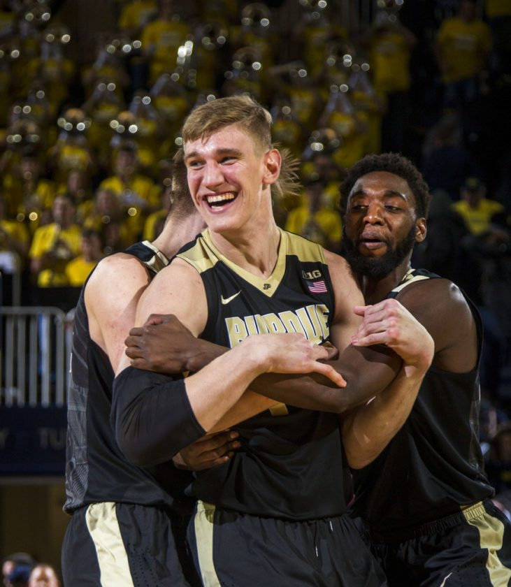 Purdue center Isaac Haas, center, celebrates with forwards Matt Haarms, left, and Jacquil Taylor, right, after making the game-winning free throw at the end of a game against Michigan at Crisler Center in Ann Arbor, Mich. Tuesday. (By The Associated Press)