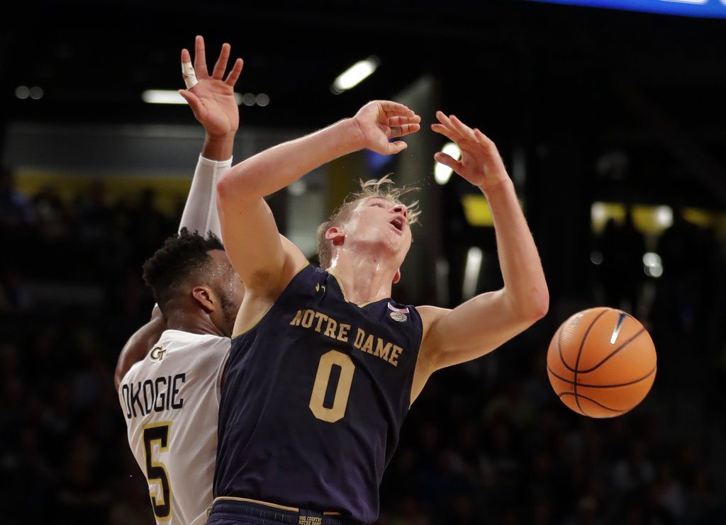 Notre Dame guard Rex Pflueger (0) has the ball knocked away by Georgia Tech guard Josh Okogie (5) during the first half of a game Wednesday in Atlanta. (By The Associated Press)