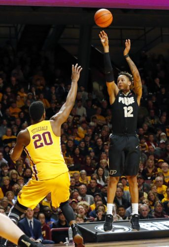 Purdue's Vincent Edwards, right, shoots over Minnesota's Davonte Fitzgerald in the first half of a game Saturday in Minneapolis. Purdue won 81-47. (By The Associated Press)