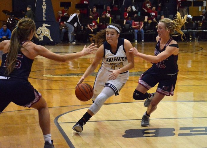 Norwell's Logan Rowles, center, drives on Bellmont's Grace Hunter, right, during Norwell's 61-49 win on Saturday at Norwell. (Photo by Reggie Hayes of news-sentinel.com)