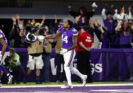Minnesota Vikings wide receiver Stefon Diggs (14) celebrates in the end zone after a game winning touchdown against the New Orleans Saints on Sunday. (Photo by the Associated Press)