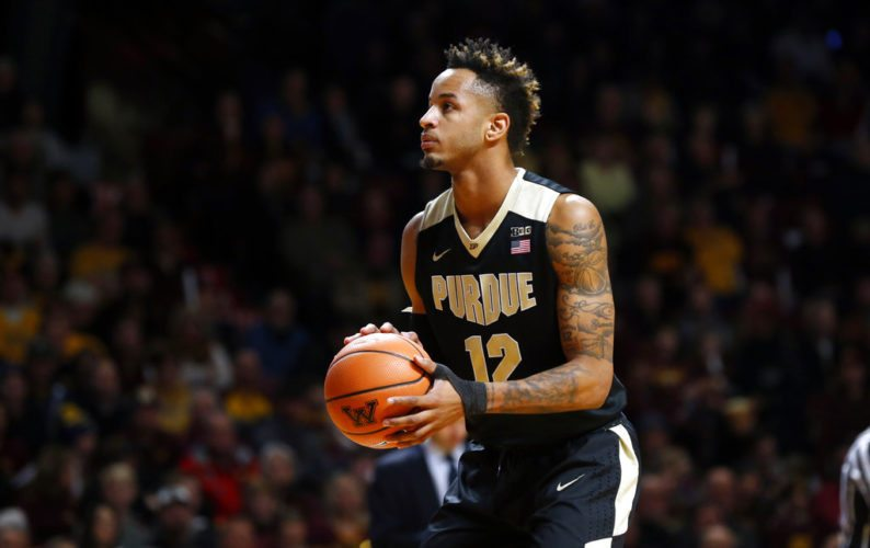 Purdue's Vincent Edwards plays against Minnesota in the first half of a game Saturday in Minneapolis. (By The Associated Press)