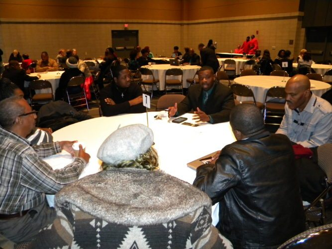 "Amos Norman, back of table, discusses ""The Power of Influence"" during his roundtable discussion Monday at the local Martin Luther King Jr. Club's Unity Day Celebration at the Grand Wayne Convention Center.  In addition to the roundtable discussions, the event included award presentations, entertainment, and vendors and information booths. (By Kevin Kilbane of News-Sentinel.com)"