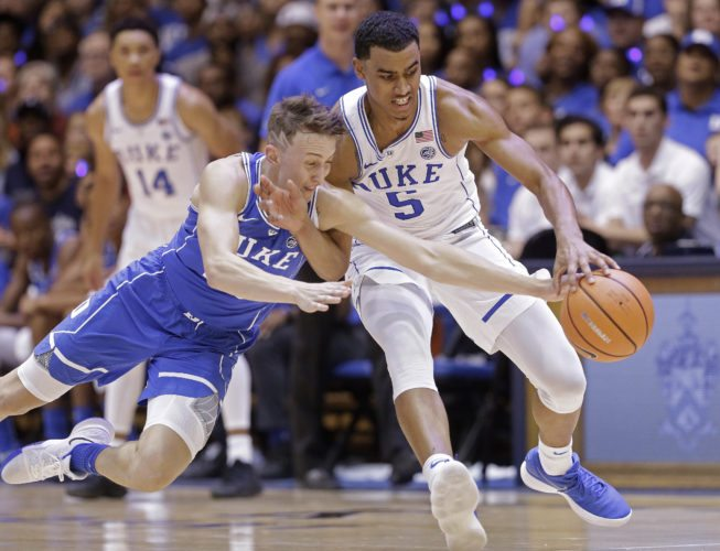 Duke's Alex O'Connell, left, and Jordan Tucker (5) chase the ball in the Blue-White scrimmage earlier this season in Durham, N.C. (By The Associated Press)
