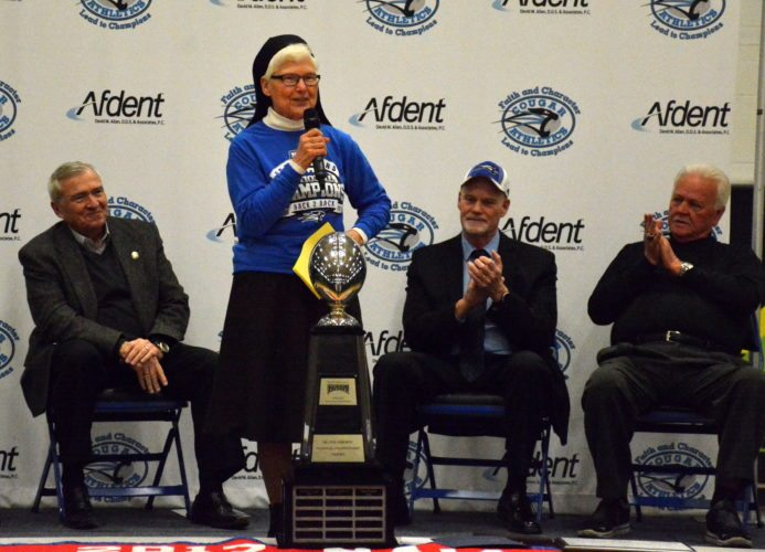 University of Saint Francis President Sister M. Elise Kriss, center, talks Tuesday at the community celebration. Listening to her, from left, is Mayor Tom Henry, County Commissioner Nelson Peters and Saint Francis football coach Kevin Donley. (Photo by Reggie Hayes of news-sentinel.com)