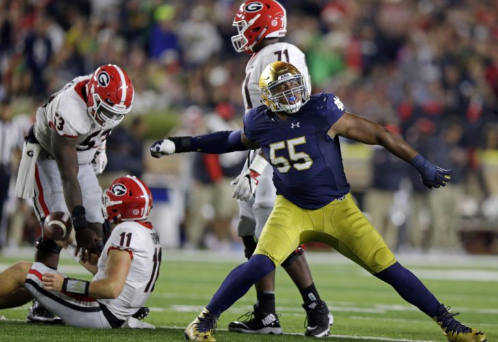 Notre Dame defensive lineman Jonathan Bonner (55) celebrates a sack of Georgia quarterback Jake Fromm (11) during the second half of a game in South Bend this past season. (By The Associated Press)
