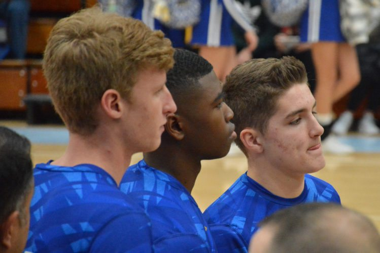 Homestead captains Sam Buck, Onye Ezeakudo and Grant Raber listen to instructions during a game in the SAC Holiday Tournament in December. (Photo by Dan Vance of news-sentinel.com)
