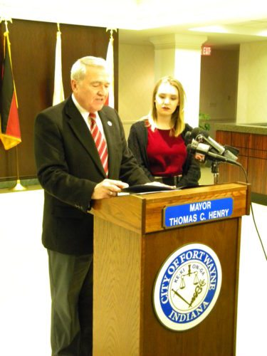 """Addison Agen, right, listens as Mayor Tom Henry reads a proclamation naming Wednesday as Addison Agen Day in Fort Wayne. Henry honored Addison for her runner-up finish last month on the TV show """"The Voice."""" (By Kevin Kilbane of News-Sentinel.com)"""