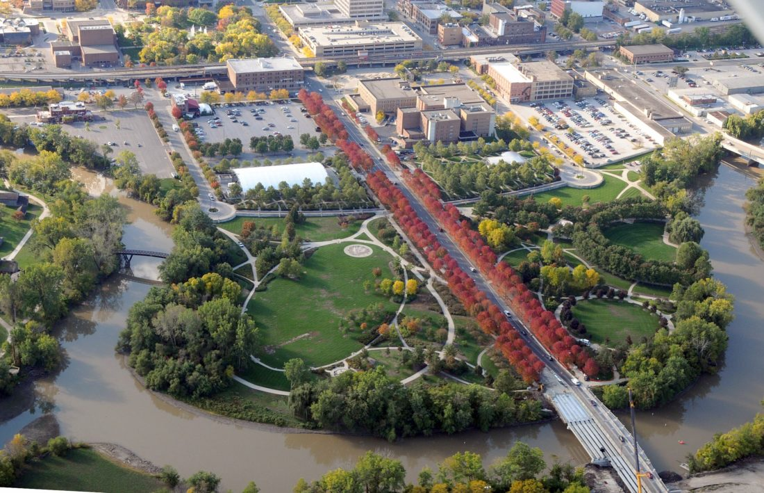 This aerial view shows Headwaters Park in the foreground and downtown Fort Wayne in the background. The Headwaters Park Alliance, which has managed the park for about 18 years, is preparing to pass management responsibilities to the Fort Wayne Parks and Recreation Department, which owns the park. (News-Sentinel.com file photo)