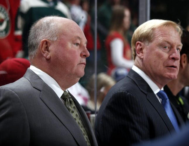 Former Komets player and coach Bruce Boudreau, left, is in his second season as coach of the Minnesota Wild. Former Komets player John Anderson, right, is his top assistant. (Photo courtesy of Minnesota Wild)