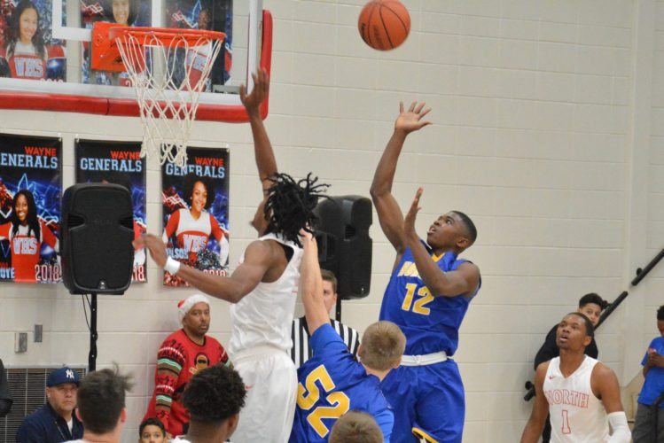 Homestead's Onye Ezeakudo shoots over North Side's Keion Brooks Jr. during December's SAC Holiday Tournament. The two teams meet again on Friday. (Photo by Dan Vance of news-sentinel.com)