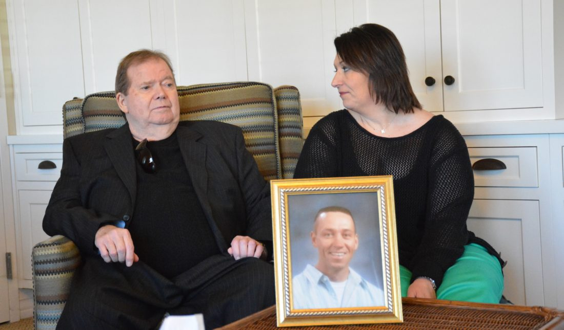 Bill Coldwell, left, and Kaye Simmons talk recently about Kaye's brother Billy Vernon, shown in the picture frame. Vernon was an organ donor, and Coldwell received Vernon's heart after Vernon was killed in April 2005.