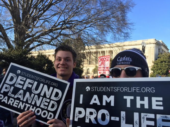 Concordia Lutheran High School students carry signs during the March for Life on Friday afternoon in Washington, D.C. They were among four busloads of students and chaperones from the Fort Wayne area who participated in the march. (By Amanda Williams for News-Sentinel.com)