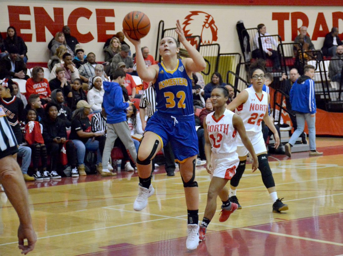 Homestead sophomore Sydney Graber goes up for a layup at North Side on Friday night. (Photo by Dan Vance of news-sentinel.com)
