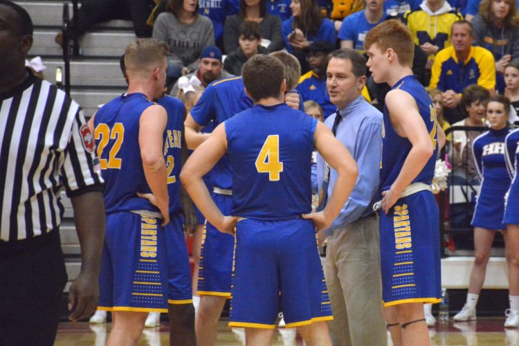 Homestead coach Chris Johnson regroups his team after an intentional foul was called against them on Friday night at North Side. (Photo by Dan Vance of news-sentinel.com)
