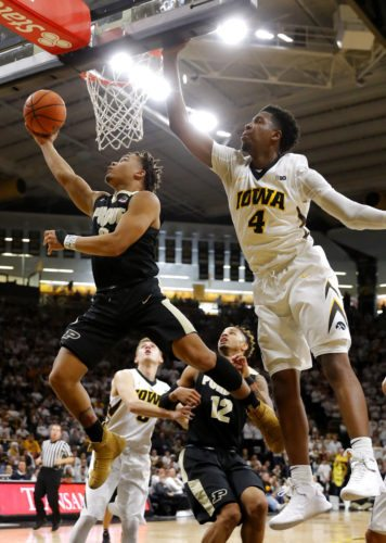 Purdue guard Carsen Edwards drives to the basket past Iowa guard Isaiah Moss (4) during the first half of a game Saturday in Iowa City, Iowa. (By The Associated Press)