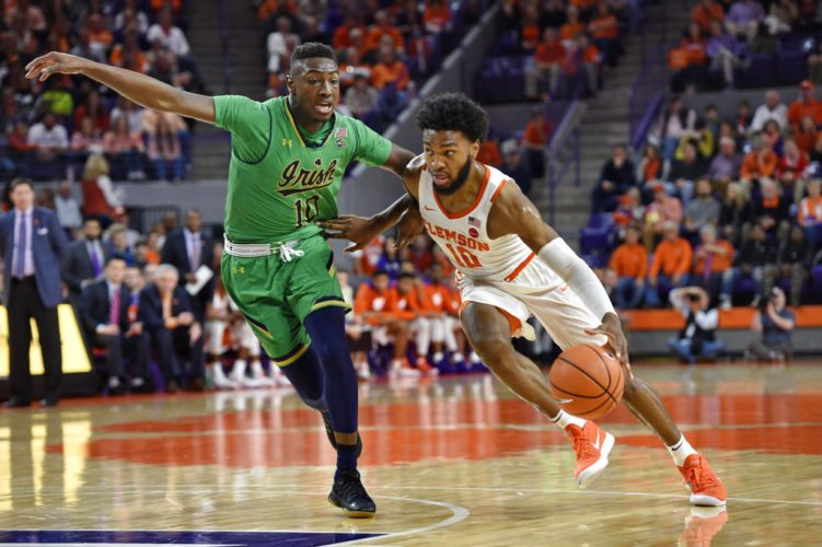 Clemson's Gabe DeVoe, right, drives against Notre Dame's T.J. Gibbs Jr. during the first half of a game Saturday in Clemson, S.C. (By The Associated Press)