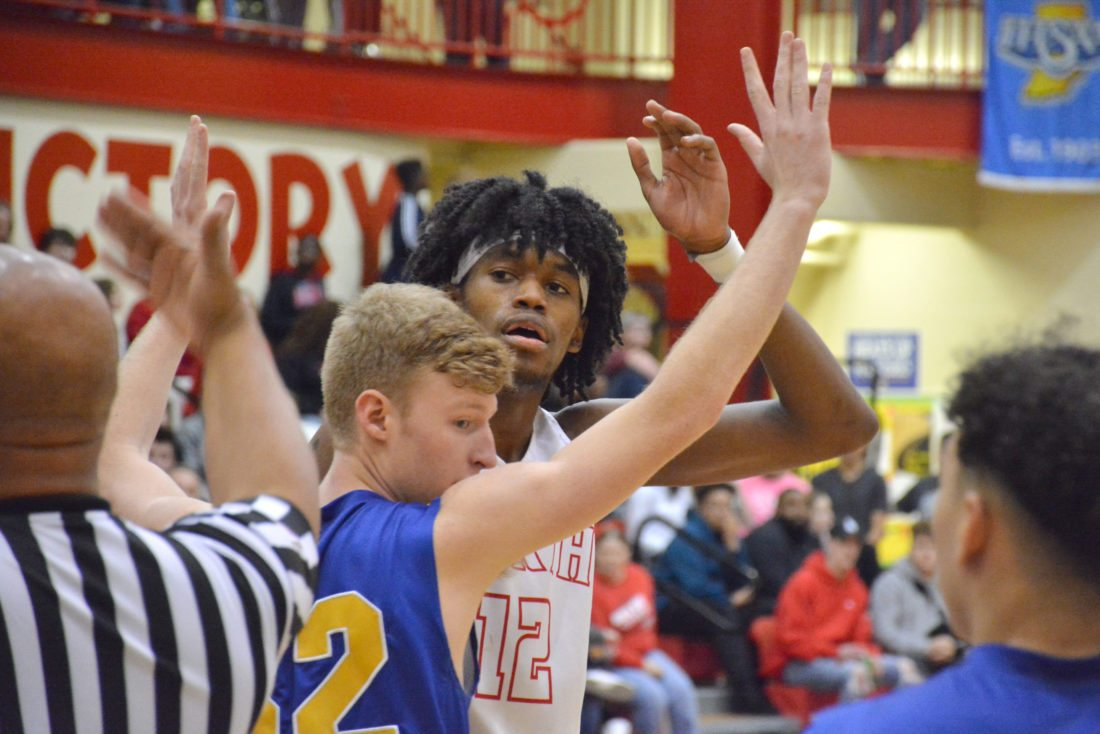 North Side junior Keion Brooks Jr. awaits an inbounds pass while being guarded by Homestead senior Sam Buck on Friday night. (Photo by Dan Vance of news-sentinel.com)