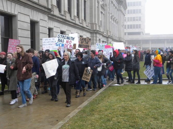 After listening to several speakers, people attending the Women's March event Sunday afternoon at the Allen County Courthouse green went on a brief march in downtown Fort Wayne. (By Kevin Kilbane of News-Sentinel.com)