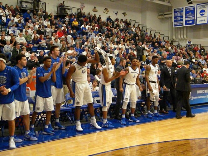 The Fort Wayne bench erupts in celebration following a play against IUPUI at the Gates Sports Center last season. (By Tom Davis of News-Sentinel.com)