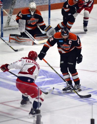 Komets captain Jamie Schaafsma blocks a shot from Allen's Anthony Calabrese during the first period Sunday night. (By Blake Sebring of News-Sentinel.com)