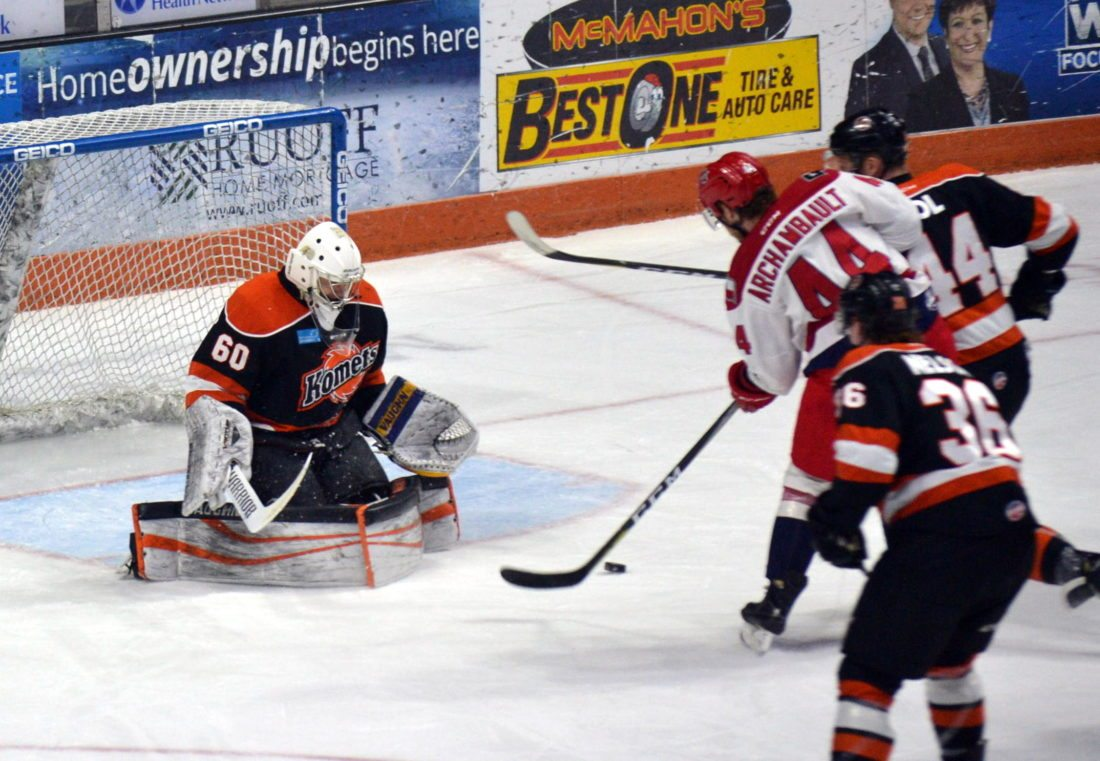 Komets goaltender Garrett Bartus slams the pads shut to stop a second-period scoring attempt by Allen's Olivier Archambault during Sunday's game at Memorial Coliseum. (By Blake Sebring of News-Sentinel.com)
