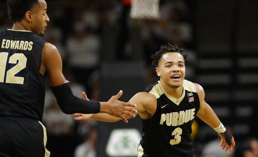 Purdue guard Carsen Edwards, right, celebrates with teammate Vincent Edwards, left, after making a 3-point basket against Iowa on Saturday in Iowa City, Iowa. (Photo by the Associated Press)