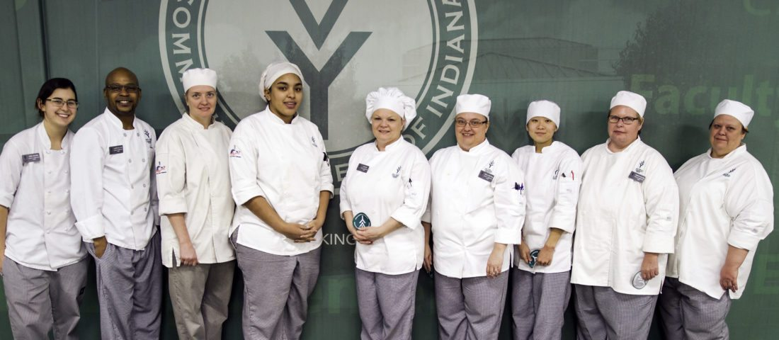 Eleven hospitality administration students competed Friday in Ivy Tech Fort Wayne's European Competition. Eight students won the opportunity to travel to France to study the culinary arts, and the three remaining students will get to take a farm-to-fort tour in May in Vermont. The competing students, from left, are Reba Wilson (France), La'Ron Gillard (Vermont), Joyce Chaney (France), DominiQue Whetstone (France), Lisa Rios (France), Sheila Mertens (Vermont), Nora Trittipo (France), Samantha Williams (France), and Patricia Jones (Vermont). Not pictured were Jason Elkins and Jacob Burger, both of whom are going to France. (Courtesy of Ivy Tech Fort Wayne)