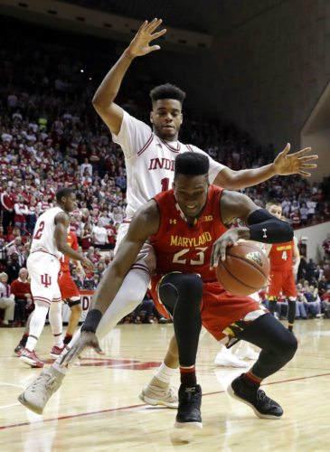 Maryland's Bruno Fernando (23) is defended by Indiana's Juwan Morgan during the first half of a game Monday in Bloomington. (By The Associated Press)