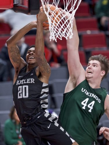 Butler guard Henry Baddley, left, has a shot blocked by Portland State center Ryan Edwards during the first half of a game earlier this season at the Phil Knight Invitational tournament in Portland, Ore. (By The Associated Press)