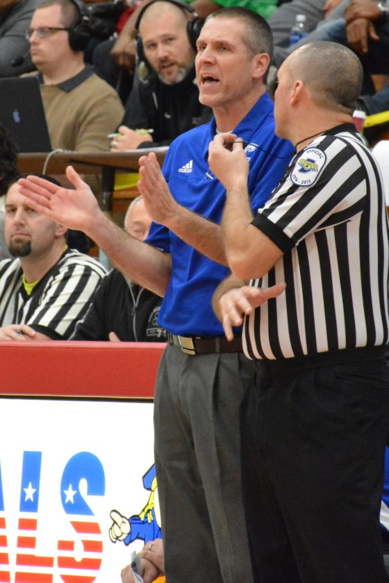 Carroll boys basketball coach Marty Beasley discusses a call with an official during a 2016 game of the  SAC Holiday Tournament. (Photo by Dan Vance of The News-Sentinel)