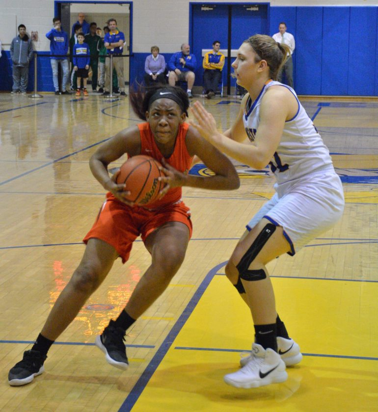 Northrop senior Breanna Douglas takes the ball to the basket against the defense of Homestead sophomore Sydney Graber on Friday night. (Photo by Justin Kenny of news-sentinel.com)