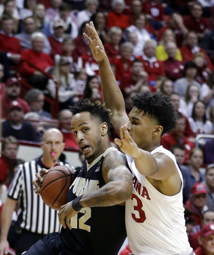 Purdue's Vincent Edwards (12) goes to the basket against Indiana's Justin Smith during the first half of a game Sunday in Bloomington. (By The Associated Press)