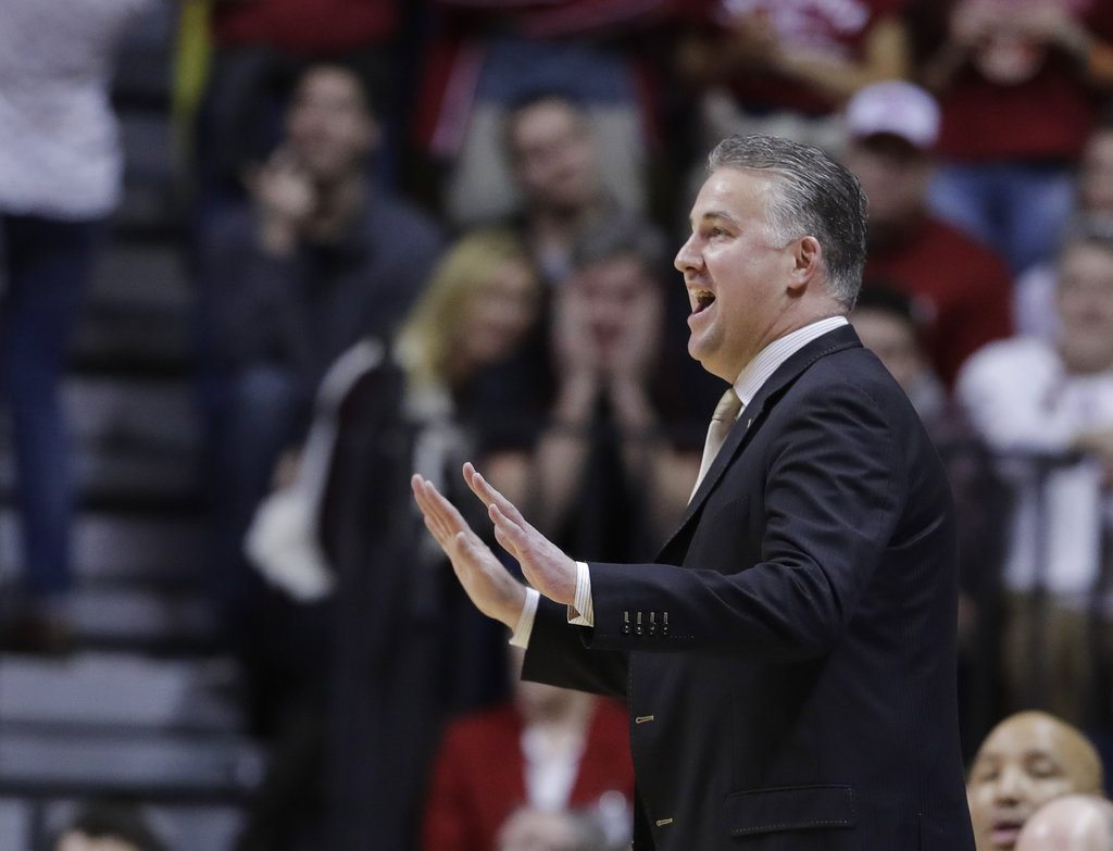 Purdue men's basketball coach Matt Painter motions to his team during the first half of a recent game against Indiana in Bloomington. (By The Associated Press)