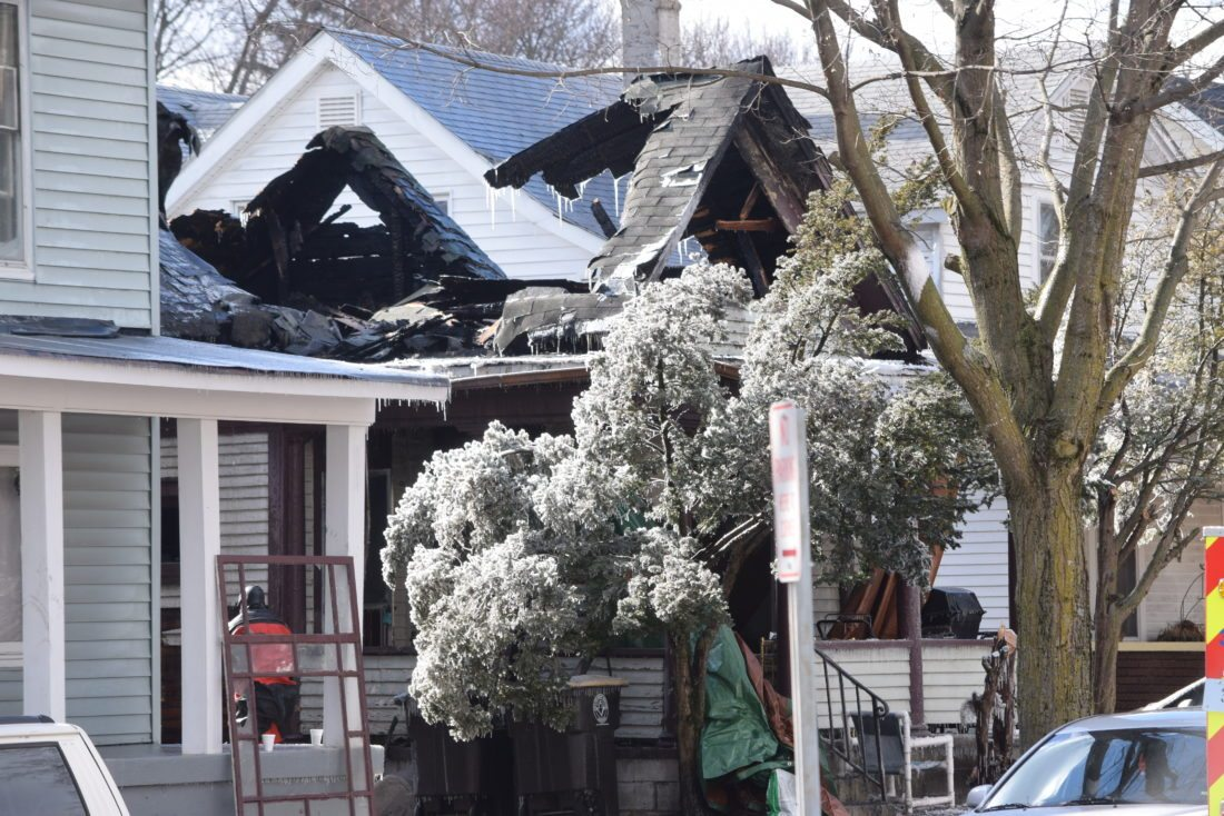 The collapsed roof of a home at 1211 Huestis Ave. is seen Friday afternoon, hours after Fort Wayne firefighters found two bodies inside. (Photo by Lisa M. Esquivel Long of News-Sentinel.com)