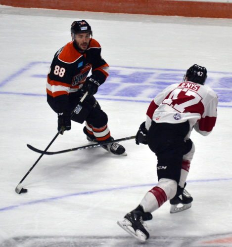 Komets center Justin Hodgman avoids a check from a Rapid City defenseman during Friday night's game. (By Blake Sebring of News-Sentinel.com)