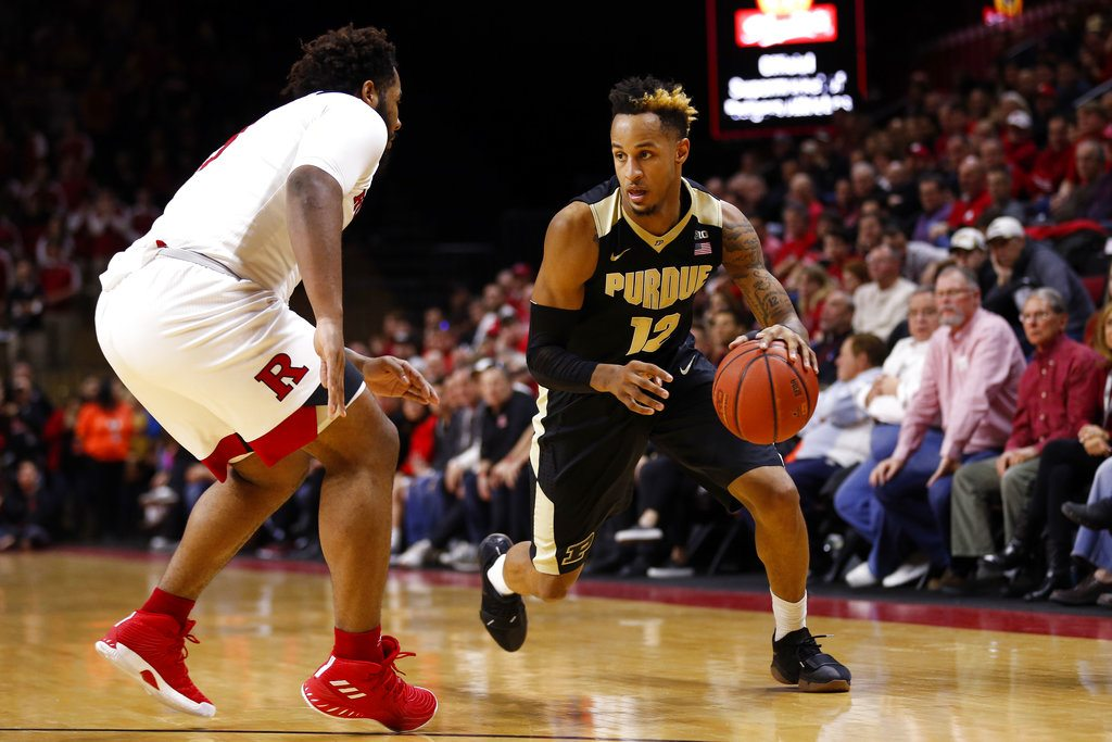 Purdue forward Vincent Edwards (12) drives to the basket past Rutgers guard Corey Sanders during the first half of a game Saturday in Piscataway, N.J. (By The Associated Press)