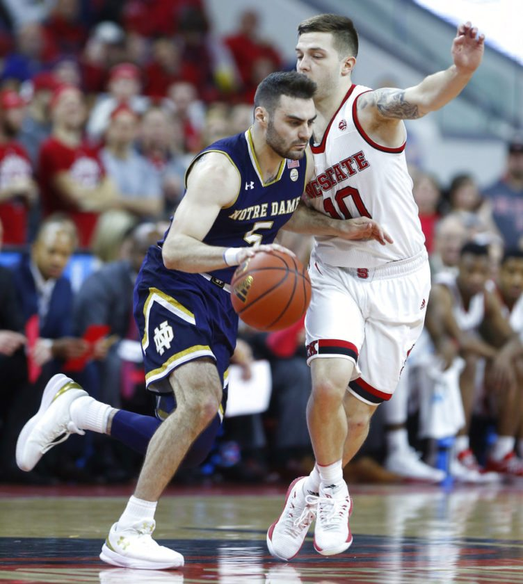 North Carolina State's Braxton Beverly (10) defends as Notre Dame's Matt Farrell (5) dribbles during the first half of a game at PNC Arena in Raleigh, N.C. Saturday. (ByThe Associated Press)