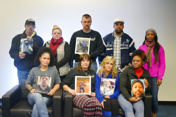Relatives hold photos of deceased loved ones they say have been overlooked by the local criminal justice system. Top row, from left, are David Miller and Amy Davis (Spencer Smith); Troy McCann (Codi McCann) ; Jamar Porter and Shauntel Lewis (Edward Campbell). Front row, from left, are Kendall White (Dontay White); Stacey Davis (Codi McCann); Tina Clark (Madison Clark) and Oprah Scott (Edward Campbell). (Photo by Lisa Esquivel Long of The News-Sentinel.com)