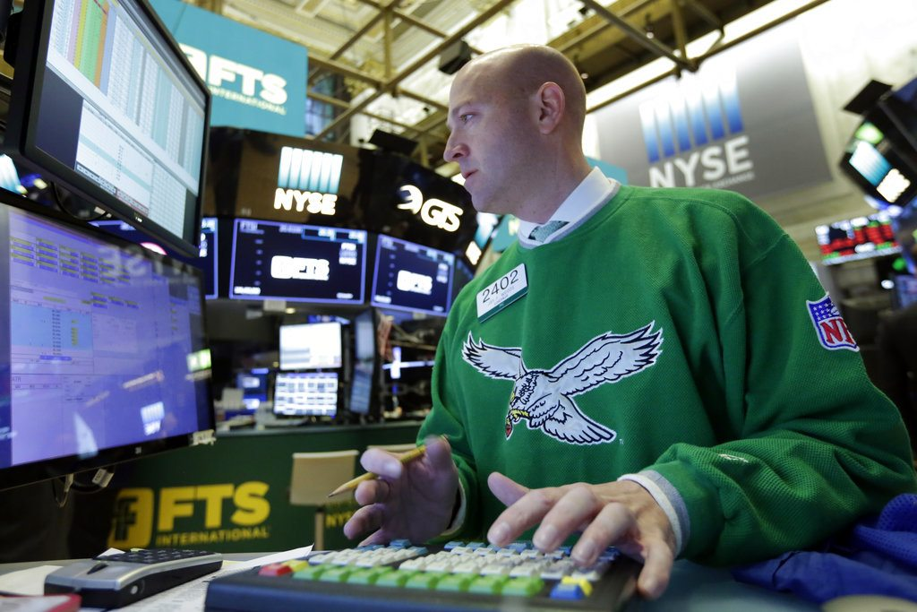Specialist Jay Woods wears a vintage Philadelphia Eagles sweater as he work at his post on the floor of the New York Stock Exchange, Monday, Feb. 5, 2018. Stock markets around the world took another pummeling Monday as investors continued to fret over rising U.S. bond yields. (AP Photo/Richard Drew)