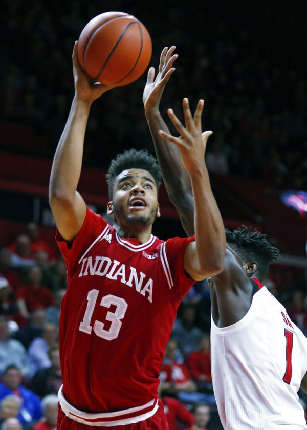 Indiana forward Juwan Morgan (13) drives to the basket past Rutgers forward Candido Sa during the first half of a game Monday in Piscataway, N.J. (By The Associated Press)