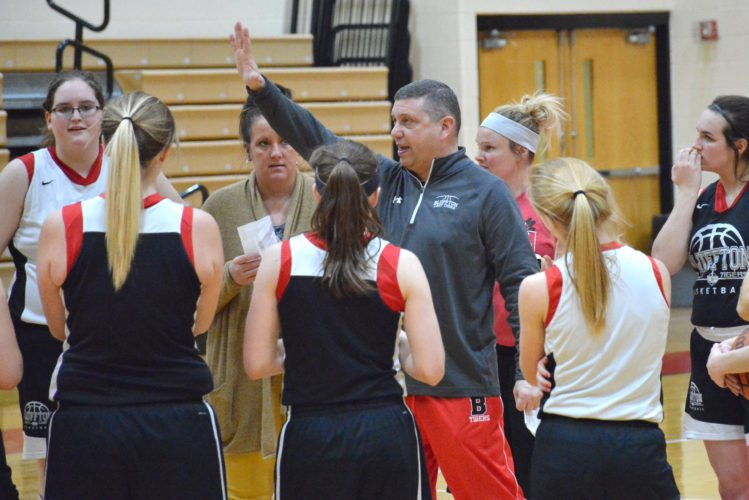 Bluffton girls basketball coach Karl Grau talks to the team during practice on Monday. (Photo by Dan Vance of news-sentinel.com)