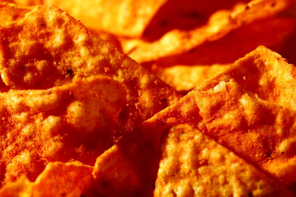 """This Sept. 26, 2014, file photo shows Nacho Cheese flavored Doritos in Philadelphia. Don't expect to see """"lady Doritos"""" on store shelves. The company that makes the cheesy chips said Tuesday that it's not developing a line of Doritos designed specifically for women, despite widespread online speculation that it was. (Photo by The Associated Press)"""