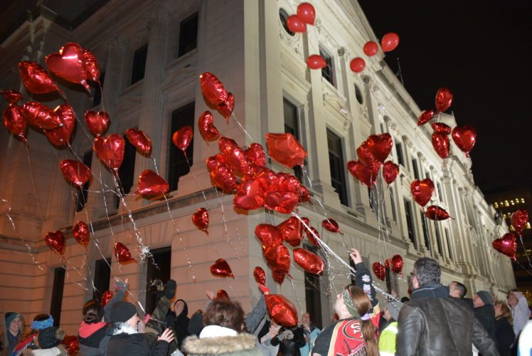 Red mylar balloons rise Tuesday night outside the Allen County Courthouse at an event on what would have been Malakai Garrett's 3rd birthday. (Photo by Lisa M. Esquivel Long of News-Sentinel.com)